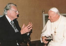"Billy Graham and John Paul II in 1981.  In 1994, Graham was quoted as saying, ""I have found that my beliefs are essentially the same as those of orthodox Roman Catholics."""