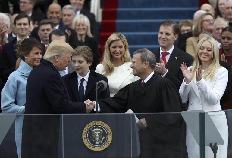 U.S. President Donald Trump shakes hands with U.S. Supreme Court Chief Justice John Roberts during inauguration ceremonies at the Capitol in Washington